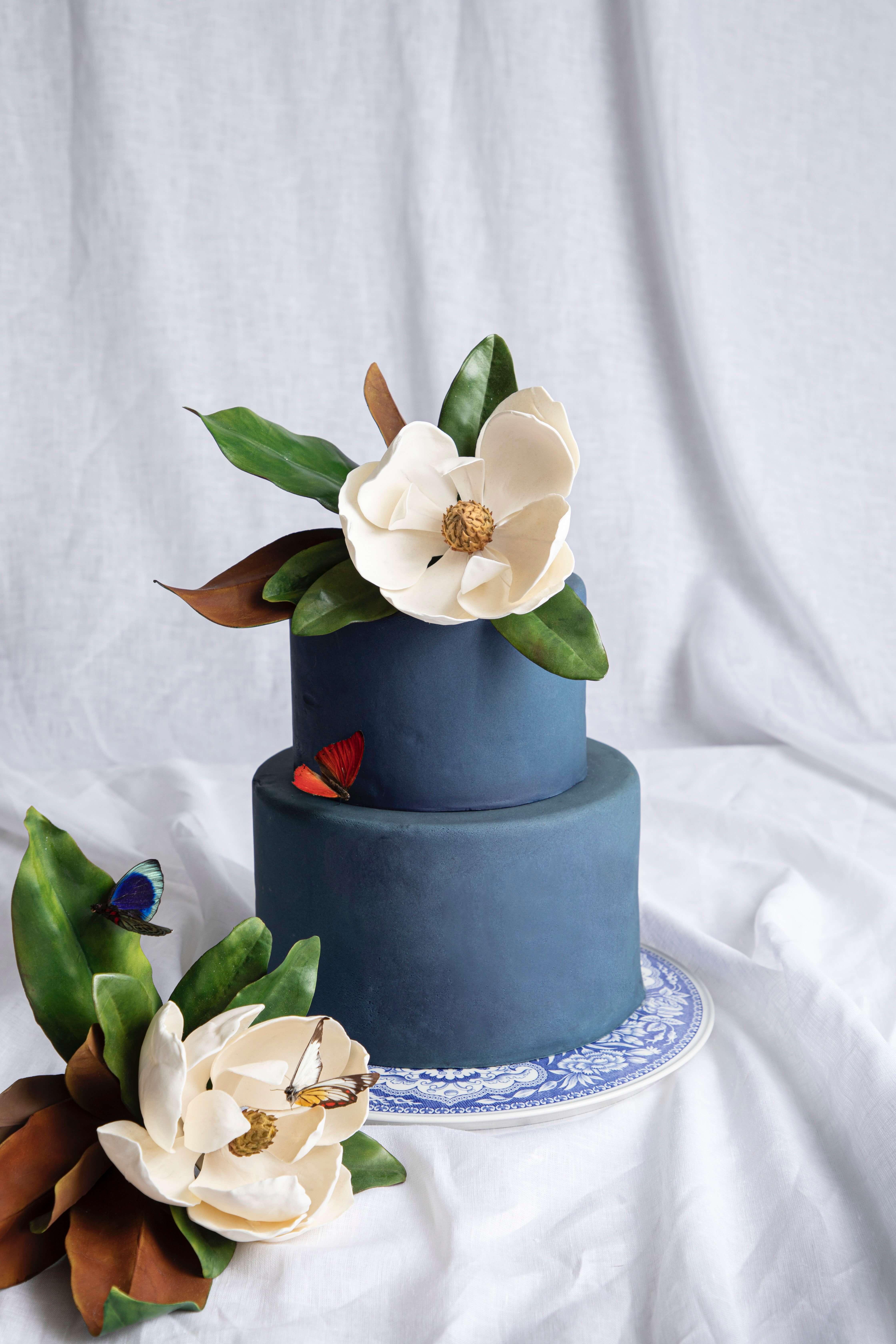Navy Custom Cake with Magnolia Sugar Flowers